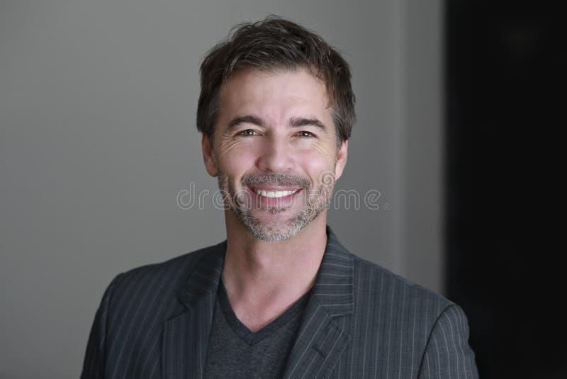 Close up OF A Mature Man Smiling At The Camera stock image