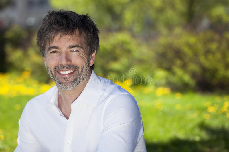 Close-up of a mature man smiling outside stock photo