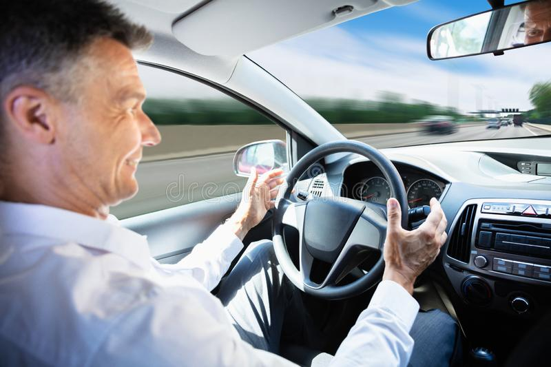 Man Traveling In Self Driving Car. Close-up Of A Mature Man Traveling In Self Driving Car royalty free stock images