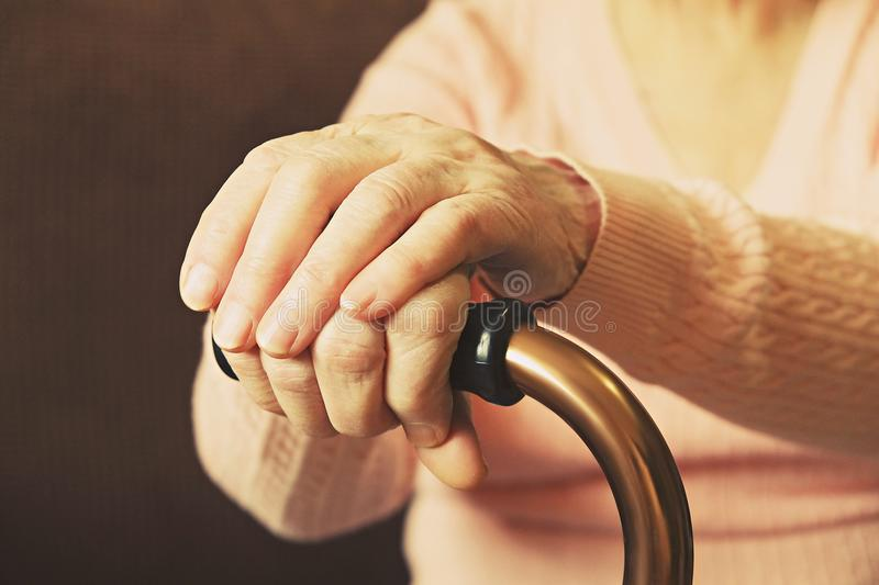 Close up of mature womans hands. Health care giving, nursing home. Parental love of grandmother. Old age related diseases. stock photo