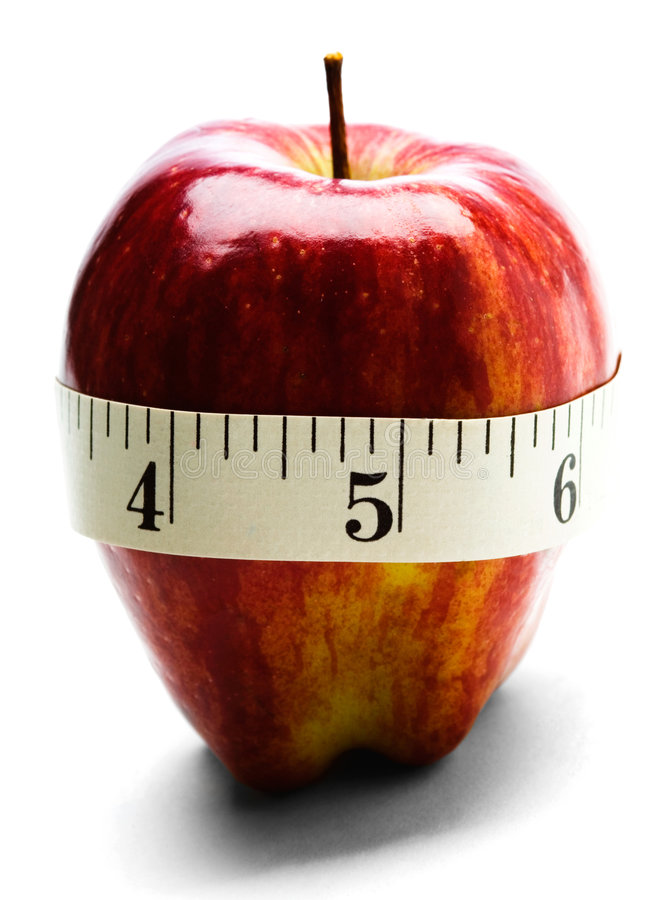 Close-Up Of Measuring Tape Wrapped Around Apple Stock Images