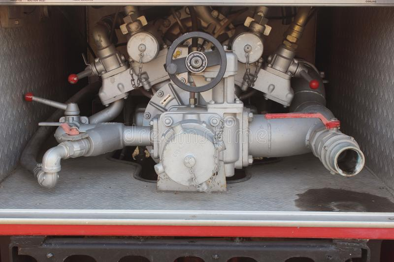 Close up on mechanics of a fire truck. Industrial, valves, mechanics royalty free stock photo