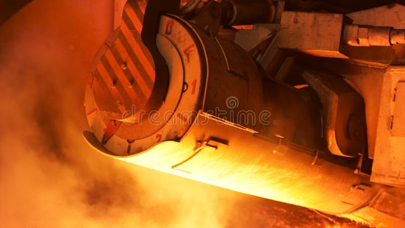 Close up for mechanism detail, steel production at a metallurgical plant. Stock footage. Heavy industry and steelworks. stock photography