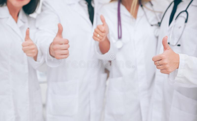 Close up. Medical personnel showing thumbs up.photo with copy sp royalty free stock photo