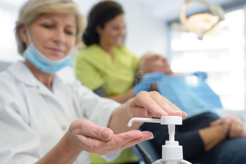 Close up medical staff washing hands stock image