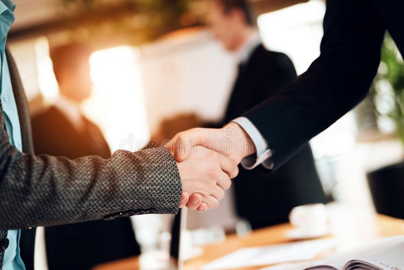 Close up. Meeting with chinese businessmen in office. Men are shaking hands. royalty free stock photos