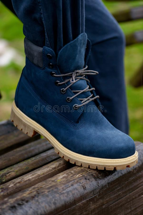 Close-up men`s boots on legs outdoor stock photo