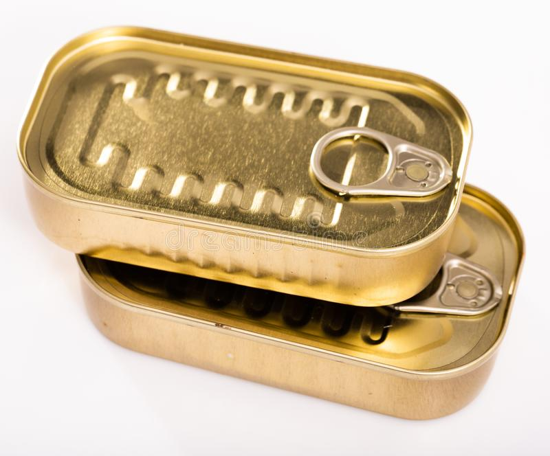 Close-up of metal bronze tin can with ring pull on white background. Nobody stock photography