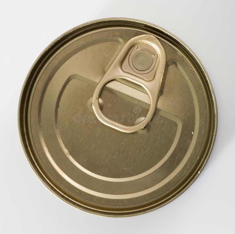 Close-up of metal bronze tin can with ring pull on white background. Nobody stock images