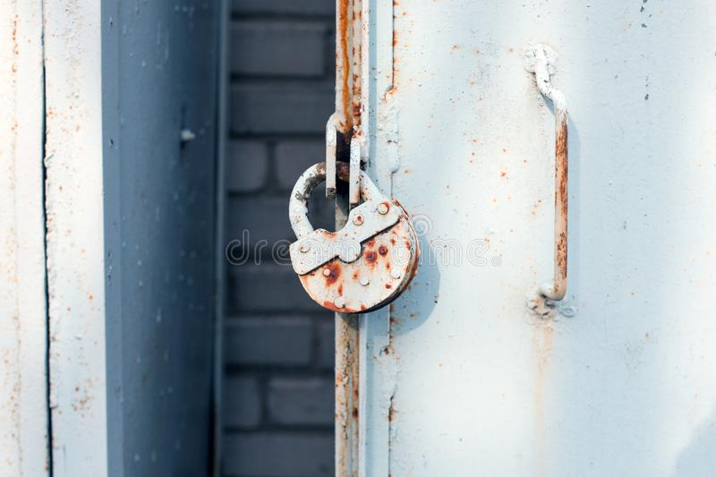 Close up of metal door with lock, grungy style. Industrial background. stock photo