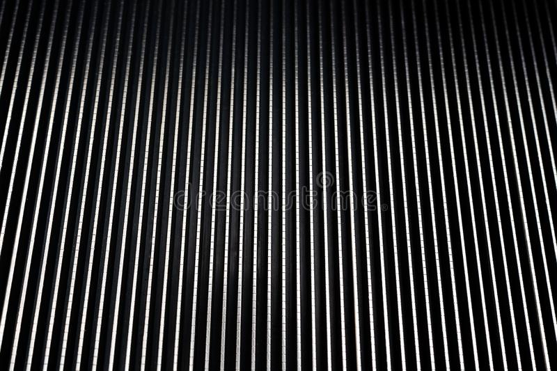 Close up metal escalator stairs, metal textures background stock photography