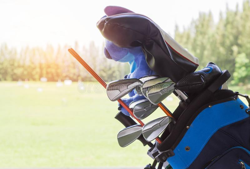 Close up metal golf clubs in bag at golf course royalty free stock photos