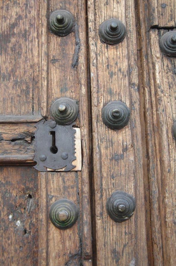Wooden door, Cusco, Peru. Close up of metal key hole in old wooden door in Cusco, Peru stock photography