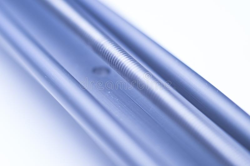 Camera Slider. Close up of a metal slider and a steel threaded rod stock images