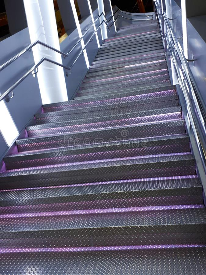 close-up of a metal staircase with backlight with blur / bokeh effect royalty free stock images