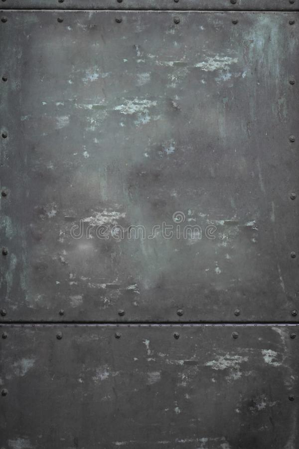 Close-up Metalic steel rectangular door with nuts texture wallpaper, Dirty rusty metalic background with shadow royalty free stock images