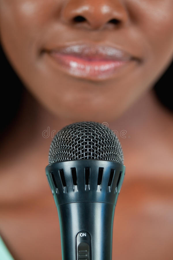 Download Close Up Of Microphone Being Used By Singer Stock Photo - Image of mouth, karaoke: 22047250
