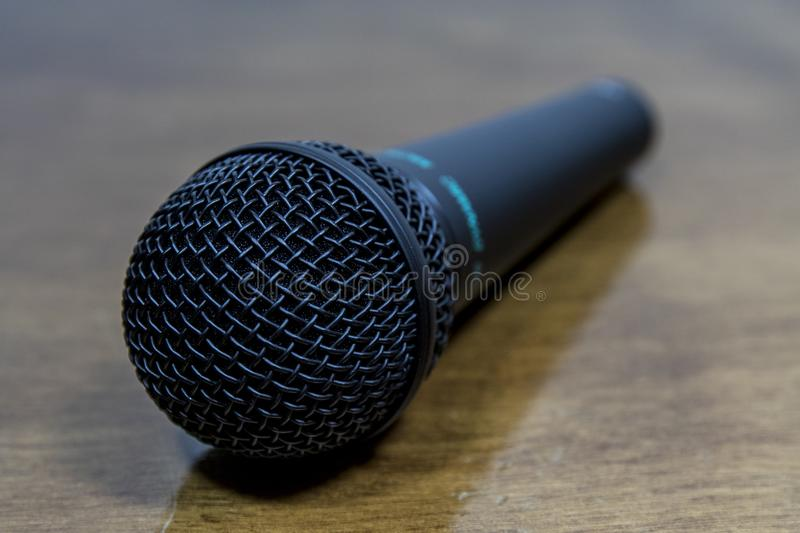 Close up of a microphone. On a blurry background stock photo