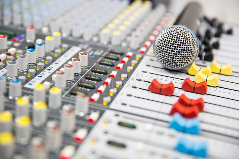 Close-up the microphone is placed on the professional audio mixer at studio for live the media and sound. Equipment production concept royalty free stock photography