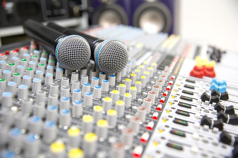 Close-up the microphone is placed on the professional audio mixer at studio for live the media. And sound equipment production concept stock photo