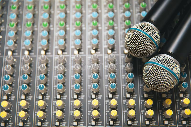 Close-up the microphone is placed on the professional audio mixer at studio. For live the media and sound equipment production concetp royalty free stock images