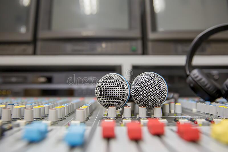Close-up the microphone is placed on the professional audio mixer at studio for live the media and sound equipment production. Concetp stock photography