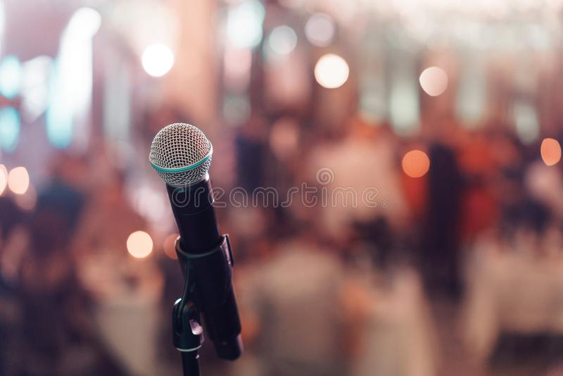 Close up microphone on stage in concert hall restaurant or conference room. Blurred background. Copy space. Close up microphone on stage in concert hall stock photos