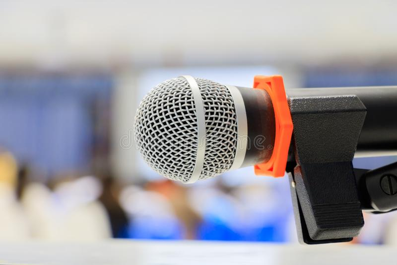 Close up microphone wireless old on Mic Stand in the conference and Background blur interior seminar meeting room.  stock photo