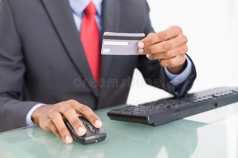 Close up mid section of a businessman doing online shopping royalty free stock image