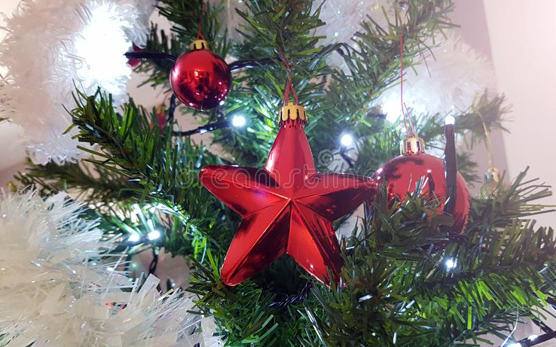 Close up on middle part of the artificial Christmas tree with beautiful Christmas ornament stock image
