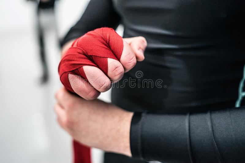 MMA boxing fighter putting hand wraps on hands stock images
