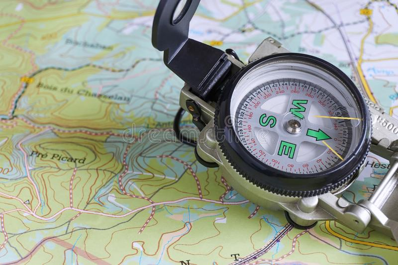Close-up of military compass on map. Of the Belgium Ardennes royalty free stock images
