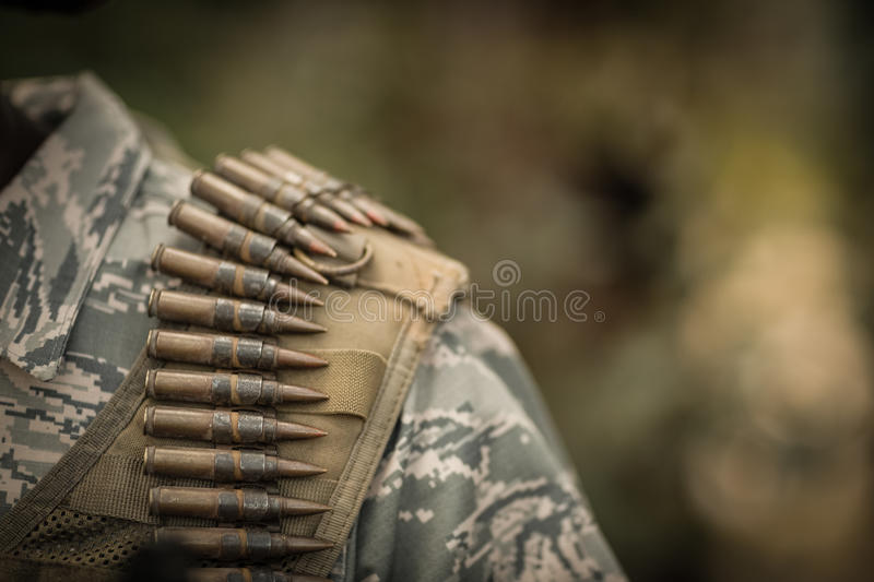 Close-up of military soldiers wearing ammunition royalty free stock photography