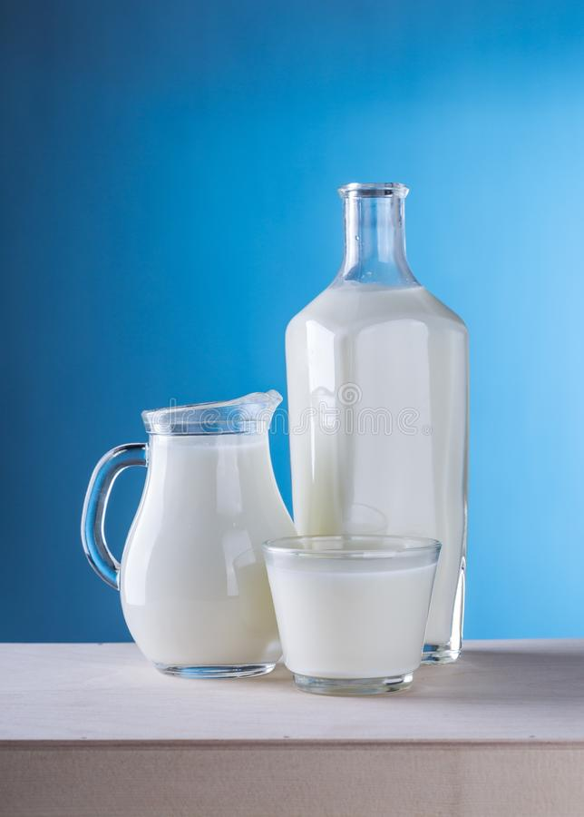 Close-up of Milk Against Blue Background stock photography