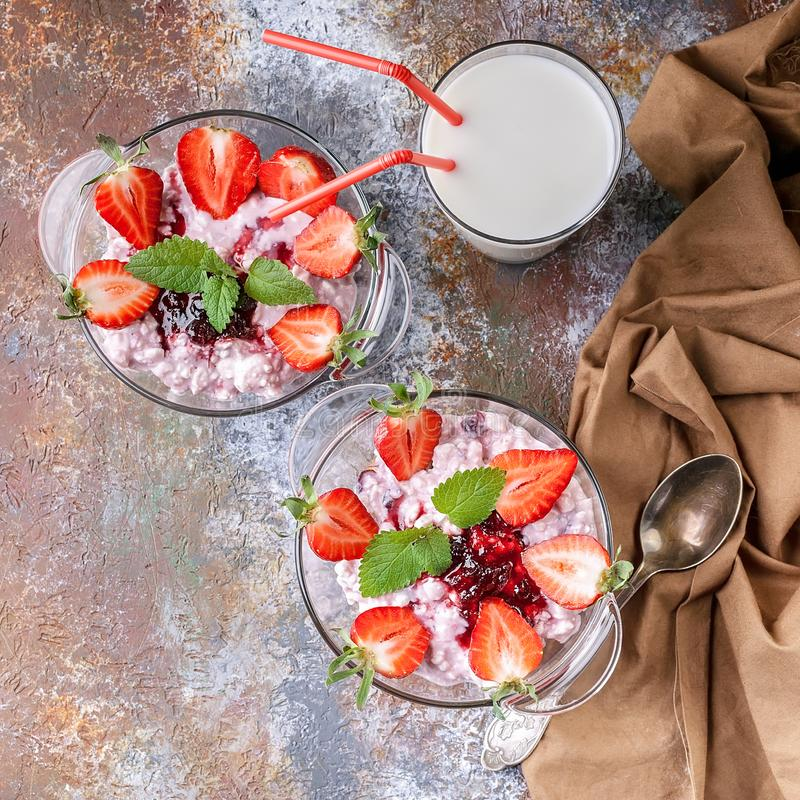 Close Up. Milk, cottage cheese, jam, yogurt with fresh strawberries and mint leaves. Top view royalty free stock images