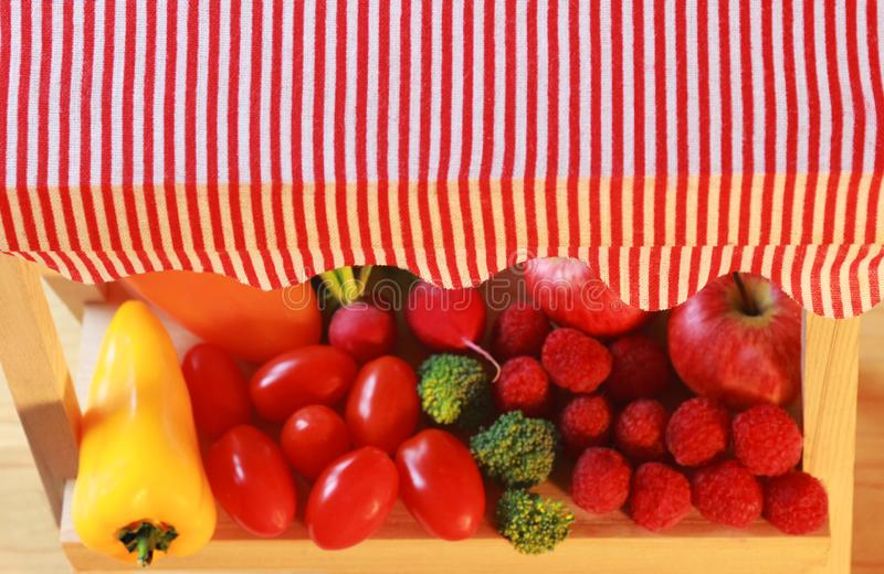 Close-up of a miniature market stall with fruits and vegetables. Seen from above royalty free stock photography