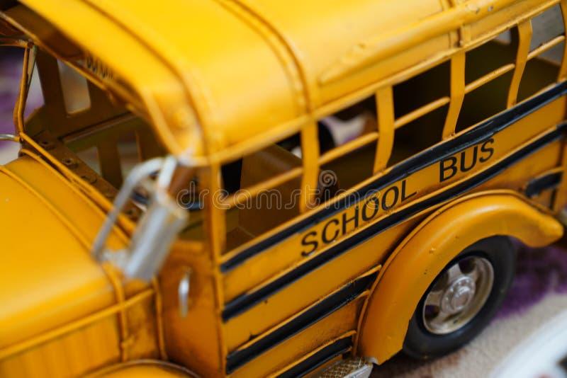 Close up miniature metal toy yellow school bus stock photos