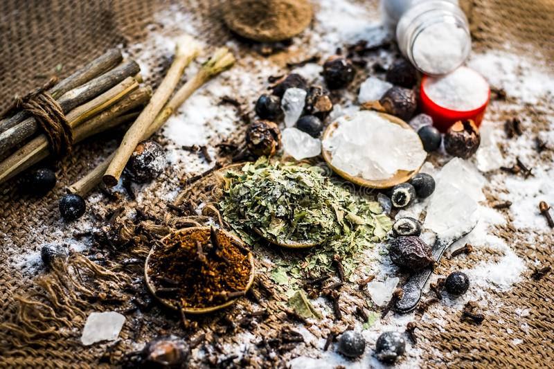 Famous medicine consisting of natural herbs to treat various tooth problems. Mixture of ayurvedic herbs for the treatment of tooth problems i.e Alum powder royalty free stock images