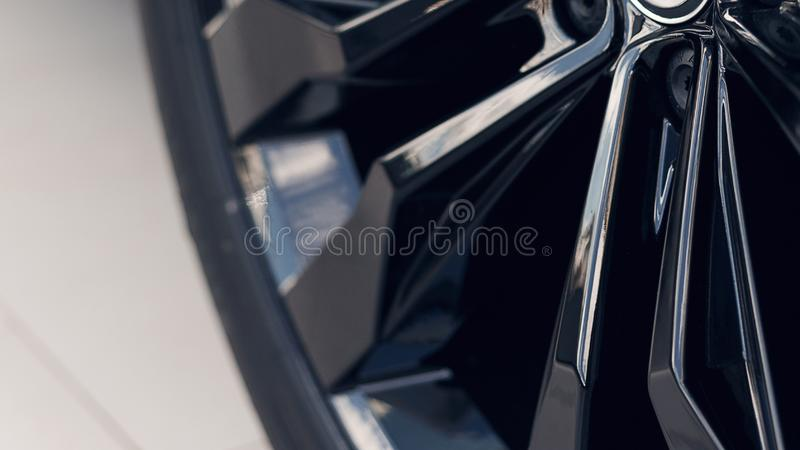 Close-up modern black wheels car. Car detail. Soft focus. Part of modern new wheel car with disk brake pad royalty free stock photo