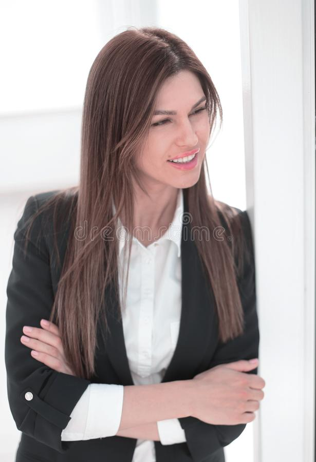 Close up.modern business woman looking through office window. royalty free stock photography