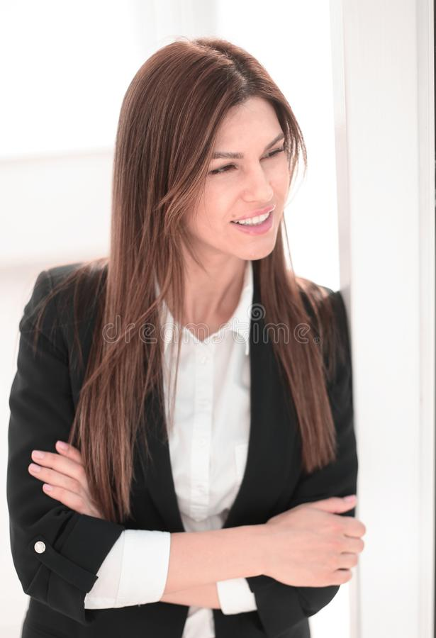 Close up.modern business woman looking through office window. stock photography