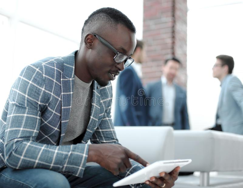 Close up.modern businessman reads the text on a digital tablet royalty free stock photo