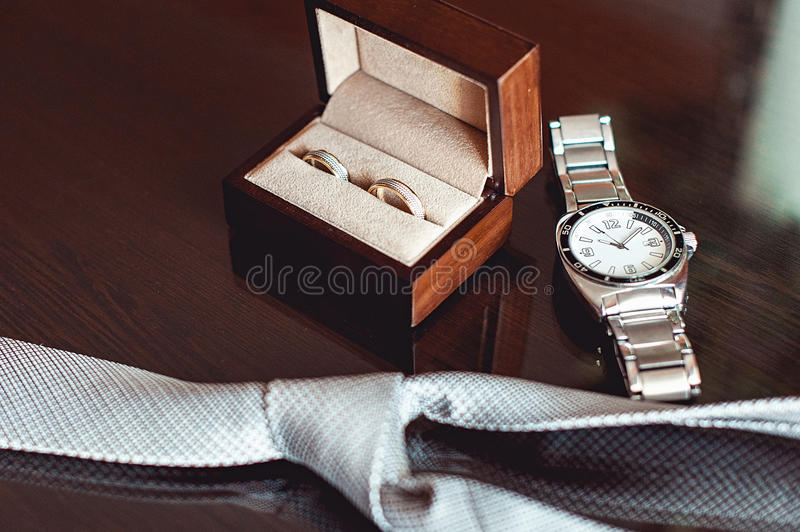 Close Up Of Modern Groom Accessories Wedding Rings In A Brown