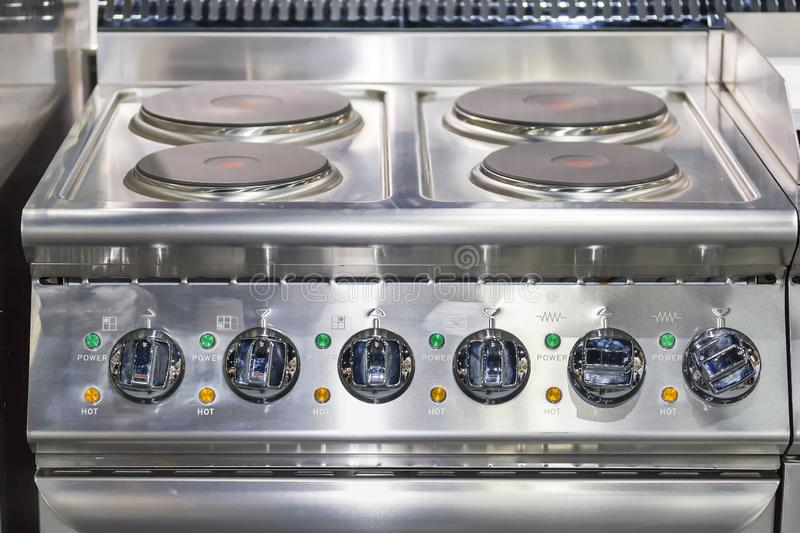 Close up modern of induction electric stove and many knob dial on control panel for industrial food royalty free stock image