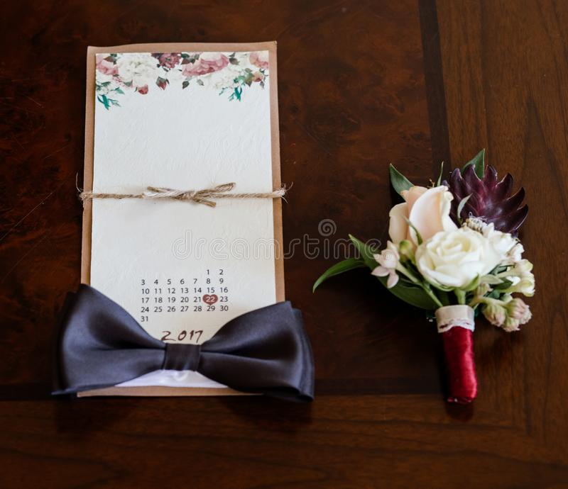 Wedding details. Groom accessories. Shoes, rings, belt, and bowt royalty free stock photos