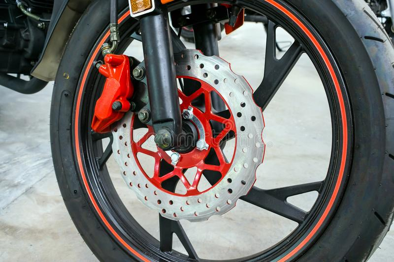 Close up of modern red motorbike brake background. New motorcycl royalty free stock image