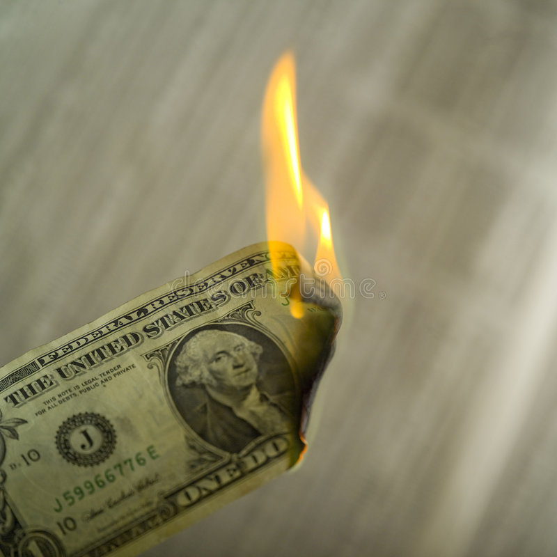 Close up of money on fire royalty free stock photo