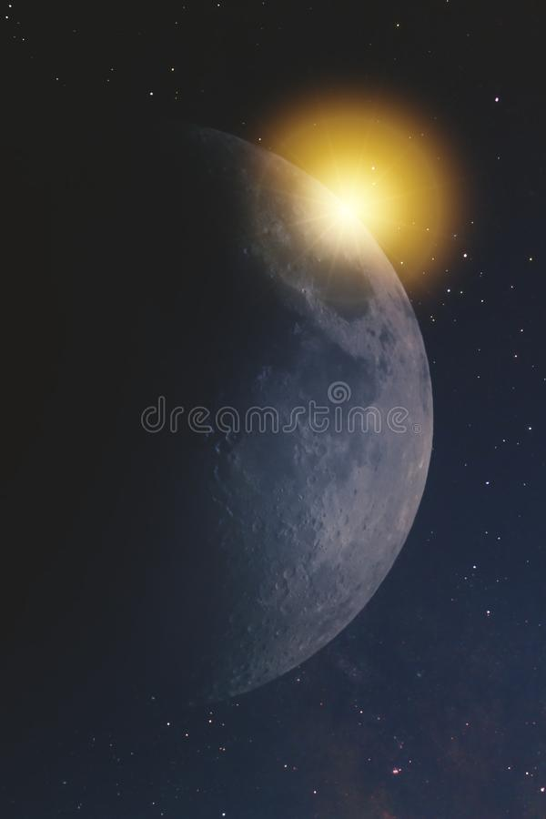 Close-up of the moon in the infinite space of the universe against the stars of the milky way with a reflection of the sun and sun. Light stock image