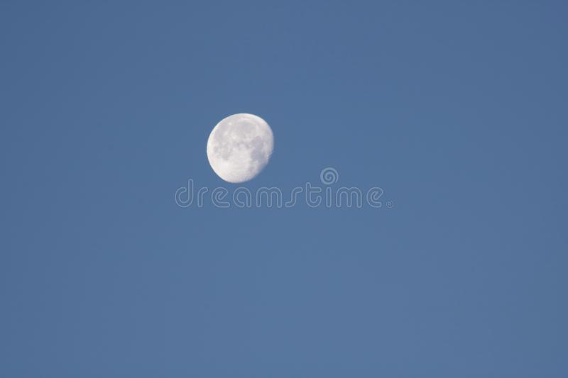 Close up of moon in the morning on blue sky background. Close up of moon texture in the morning on blue sky background royalty free stock images