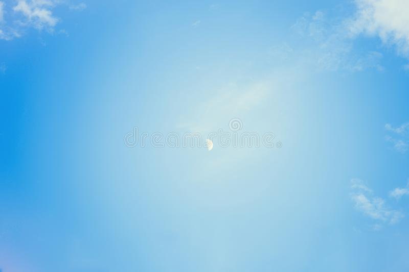 Close up of The Moon in the Morning time with blue sky background.Growing moon. Horizontal photography royalty free stock images